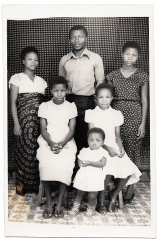 Janette Katembera, Quintin Katembera, Chantal, Eméride, Rebecca, Rachelle. From a Katembera family photo album. Photographer unknown. Goma, D.R.C., c. 1983.