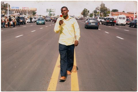 Jules Muya on Boulevard Triomphal. From a Muya family photo album. Photographer unknown. Kinshasa, D.R.C., c. 2010.