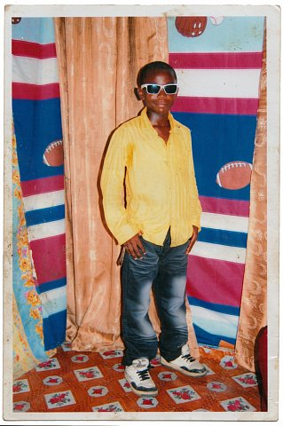 From a Muya family photo album. Photographer unknown. Kinshasa, D.R.C., c. 2010.
