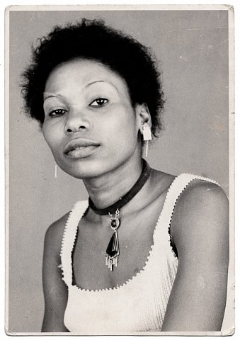 A Client. Photograph by Lema Mpeve Mervil of Studio Photo Less. Kinshasa, D.R.C., c. 1980.