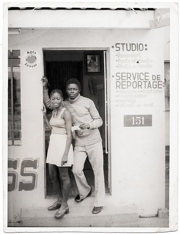Lema Mpveve Mervil and a friend in front of Studio Photo Less. Kinshasa, D.R.C., c. 1970.