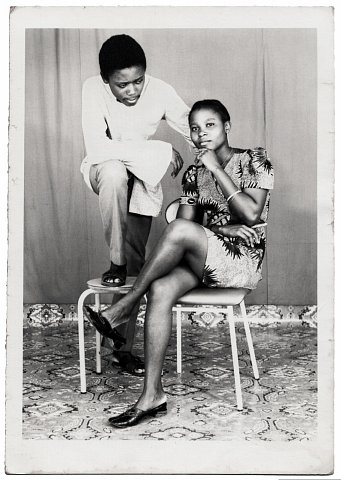 Lema and friend. Photograph by Lema Mpeve Mervil of Studio Photo Less. Kinshasa, D.R.C., c. 1975.