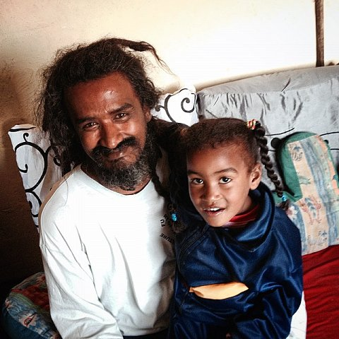 Reza Salie, 40 years old, and his daughter, Selma, 4. Reza is a Rasta and has lived in Manenberg for 38 years. His family was relocated there from District Six, where they lived on Ashley street. SS: What does Manenberg mean to you? RS: Manenberg is home. I grew up here, I won't leave. SS: How have the gangs impacted your life? RS: When I was young, I was in the Jester Kids gang. Now, it's traumatic in Manenberg when the gangs shoot. You can't do anything when they shoot, you can only look out the window. Payment for gangs is death. #southafrica #capetown #manenberg #lovefrommanenberg #gangs #father