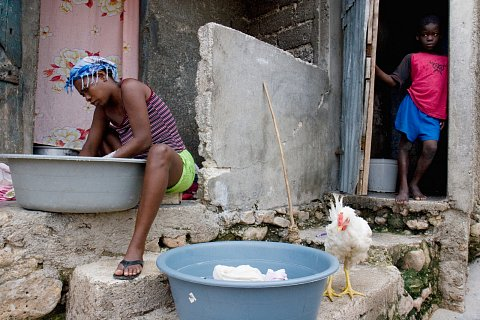 A woman washes clothes in the Grand Ravine neighborhood of Port-au-Prince, Haiti. July 21, 2007.