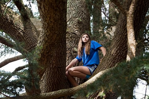 Madeline Slanski, 14, from New Hyde Park climbs a tree on the grounds of the Planting Fields Arboretum in Oyster Bay, New York. May 16, 2015.