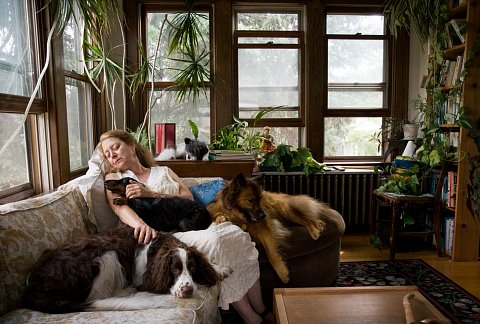Polly Vollmar-Heywood of the West Bank neighborhood in Minneapolis, Minnesota, is a horticultural therapist and the owner of four rescue dogs. July 2008.