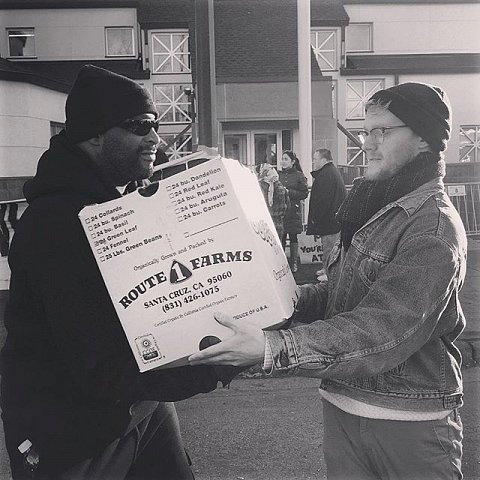 An assembly line of protesters moves food brought by Sisters' Camelot into the protesters' camps. #blacklivesmatter #releasethetapes #minneapolis #minnesota #protest #jamarclark