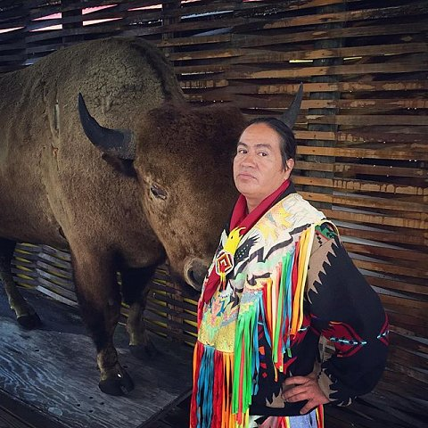 This is Jamie Pheasant, father of 5 boys and 1 girl, ages 3 - 21. Jamie, who turns 45 in March, has been dancing for tourists in Cherokee and at powwows across the nation since he was 14 years old. His descendants have been in Cherokee since the beginning of time; his family hid in the mountains to escape the Trail of Tears. Jamie entertains tourists year round in rain, snow, and sun. On good days he makes $300 - $400, on bad days $0. On this rainy day he's going home about 4:30 to take his family out to dinner. #cherokee #northcarolina #tourism #trailoftears
