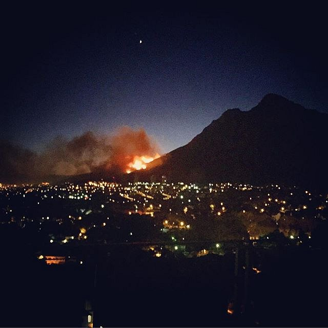 It was impossible not to wake up throughout the night to check on this fierce fire outside my window. It burned all night long on Devil's Peak. #fireonthemountain #capetown #southafrica #devilspeak #fire