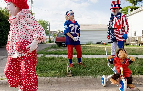 Fourth of July parade participants prepare to march in the North-End neighborhood of Saint Paul, Minnesota. 2009.