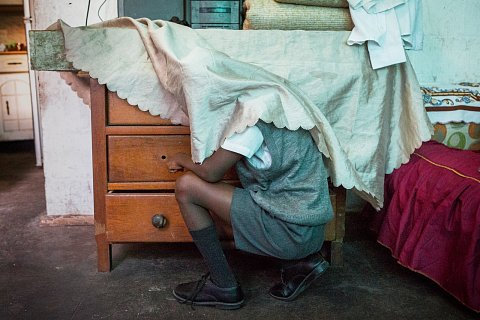 Meezie Lottering searches the drawers inside his mother's home. <br> Manenberg, March 2017.