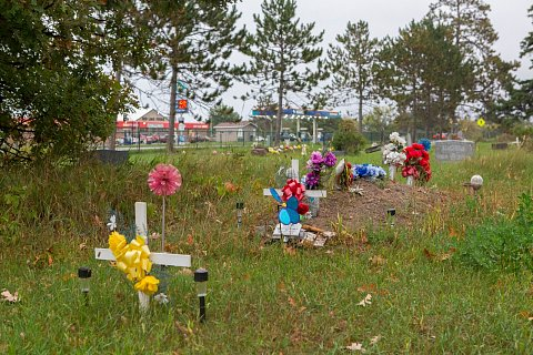 A cememetery on the Red Lake Indian Reservation in northern Minnesota. Red Lake has a high incidence of heroin and opiate related deaths as well as diabetes and heart disease. <br>September 14, 2017.