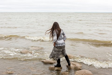 Oliva Elm, 8, from Onondaga Nation plays on the shore of Red Lake on the Red Lake Indian Reservation in northern Minnesota. Elm is visiting with her family to participate in the second annual Red Lake Food Summit. <br>September 15, 2017.