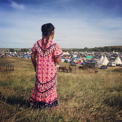 Aeris Davis, 8, looks over Sacred Stone Camp in Cannon Ball, ND. Davis is a member of the Turtle Mountain Band of Chippewa Indians. There are over 5,000 people in the camp and over 250 tribal nations are present. #NoDapl #cannonball #northdakota #usa #cleanwaterforall #sacredstonecamp